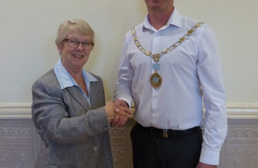Cllr Dominic Roberts receiving his Chain of Office as Mayor of Neston